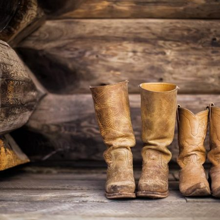 Leather boots on a wooden barn floor