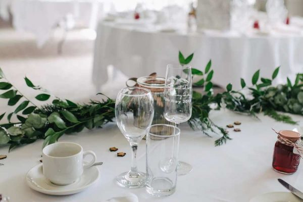 Champagne glasses on a table setting at a wedding