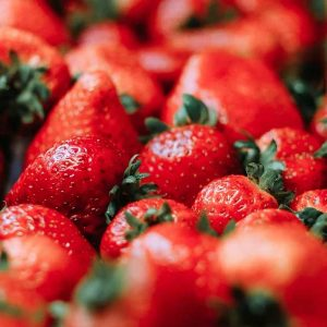 A basket full of ripe red strawberries