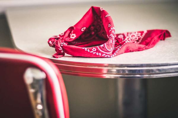 A patterned red bandana on a table